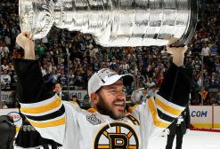 VANCOUVER, BC - JUNE 15: Mark Recchi #28 of the Boston Bruins hoists the Stanley Cup after defeating the Vancouver Canucks 4-0 in Game Seven of the 2011 NHL Stanley Cup Finals at the Rogers Arena on June 15, 2011 in Vancouver, Canada. (Photo by Dave Sandford/NHLI via Getty Images)